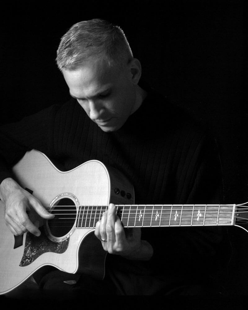 Robert Jones playing acoustic guitar
