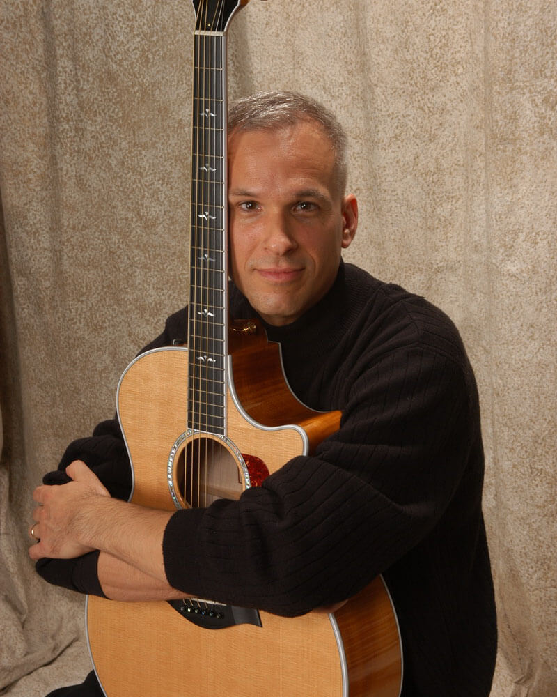 Robert Jones posing with acoustic guitar