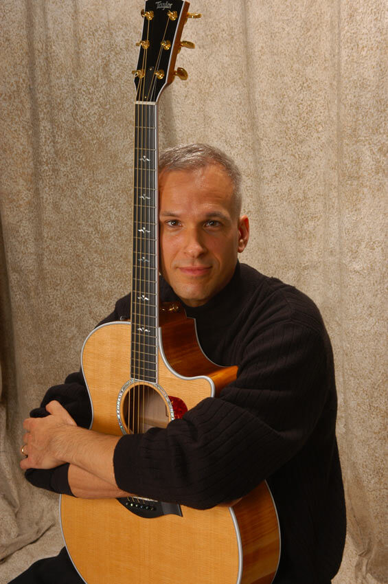 Robert Jones Guitar - Guitar Lessons with an Expert! - Robert Jones holding his guitar